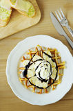Tasty waffle with banana slices Royalty Free Stock Photo