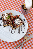 Tasty waffles with ice cream, strawberries and chocolate Stock Image