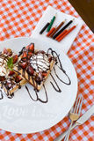 Tasty waffles with ice cream, strawberries and chocolate Royalty Free Stock Image