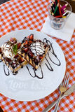 Tasty waffles with ice cream, strawberries and chocolate Royalty Free Stock Photography