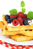 Tasty waffles with summery fruits. Whipped cream and chocolate Royalty Free Stock Photo