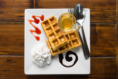 Tasty waffles on wood table Royalty Free Stock Photography