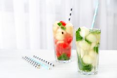 Tasty watermelon and melon ball drink in glasses. On table stock photos