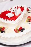 Tasty wedding cake with cream and fruits. Royalty Free Stock Image