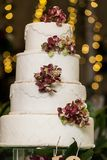 Tasty wedding cake, decorated with flowers royalty free stock photography