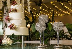 Tasty wedding cake, decorated with flowers royalty free stock image