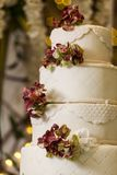Tasty wedding cake, decorated with flowers stock images