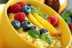 Tasty wheat porridge with berries fruit. Stock Image