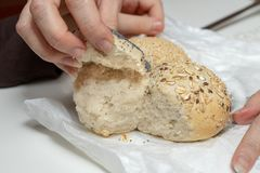 Tasty wheat roll on the kitchen table. Preparing dinner with fre stock image