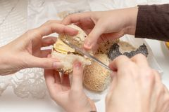 Tasty wheat roll on the kitchen table. Preparing dinner with fre royalty free stock photo