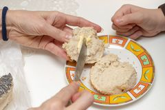 Tasty wheat roll on the kitchen table. Preparing dinner with fre stock photo