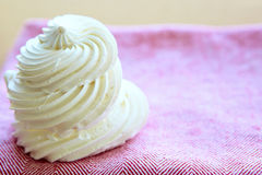 Tasty white meringue on a napkin. Royalty Free Stock Photos