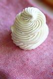 Tasty white meringue on a napkin. Stock Photos
