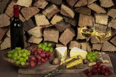 Tasty wine dinner with cheese and grapes royalty free stock images