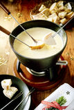 Tasty winter cheese fondue for Christmas royalty free stock photography