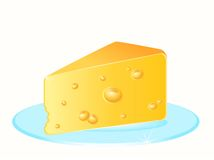 Tasty yellow cheese on a plate Royalty Free Stock Image