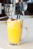 Tasty yellow cocktail with two sticks Stock Image