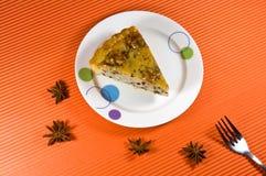 Tasty yellow honey pie with  wallnut decorations. Stock Photos