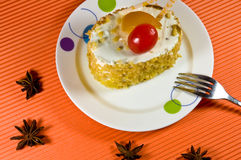 Tasty yellow nut  cake with white cream. Stock Images