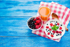Tasty yoghurt with raspberry on wood blue table. Dessert food breakfast royalty free stock images