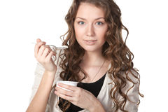 Tasty yogurt. Young female enjoying taste of yogurt isolated on white Royalty Free Stock Photo