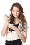 Tasty yogurt. Young female enjoying taste of yogurt isolated on white Stock Photography