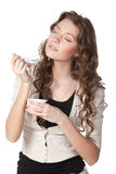 So tasty yogurt!. Young female enjoying taste of yogurt isolated on white Royalty Free Stock Photography