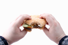 Tasty, yummy hamburger in hands Royalty Free Stock Images