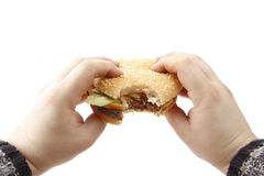 tasty, yummy hamburger in hands Stock Photography