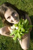 Tastyn 3. The girl in the hands of green onions and green salad Stock Photos