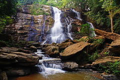 Tat Mok waterfall. A waterfall Inserted in the middle of a shady forest. In Doi Suthep - Pui national park. Falls from a cliff 20 meters high white dust royalty free stock photography