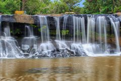 Tat Ton Waterfall. The beautiful waterfall in deep forest during raining season at Tat Ton National Park, Ubon Ratchathani province, Thailand Royalty Free Stock Photography
