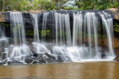 Tat Ton Waterfall. The beautiful waterfall in deep forest during raining season at Tat Ton National Park, Ubon Ratchathani province, Thailand Stock Photos