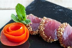 Tataki detail on black plate. Royalty Free Stock Photos