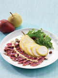 Tataki salad with pear and hazelnuts Stock Images
