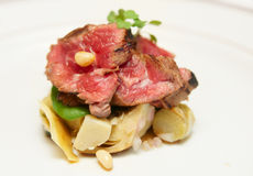 Tataki style fried beef with artichokes Stock Images