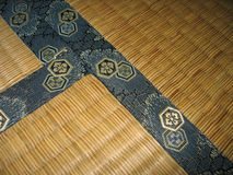 Tatami floor - detail. Japanese traditional floor, called tatami. This detail includes the joint of 3 tiles Stock Images