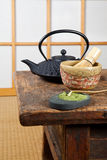 Tatami with green tea. Tatami mat and green powder tea with teapot and bamboo whisk for zen ceremony Stock Image