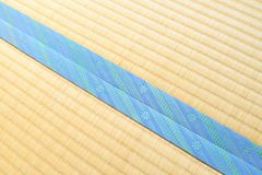 Tatami with light blue edging, ribbon. Tatami with light blue flower ribbon Stock Photography