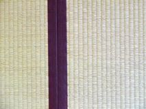 Tatami mat closeup with violet edging (heri). Straws visible Stock Photography