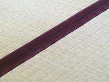 Tatami mat closeup with violet edging (heri). Straws visible Stock Photo