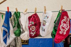 Tatar and Bashkir female traditional vintage hats hang for sale on clothespins on a rope royalty free stock photography