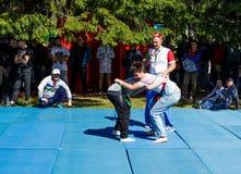 Tatar belt wrestling, kuresh. Traditional national holiday Sabantuy in the city park. Yekaterinburg, Russia, June 15, 2019. Tatar belt wrestling, kuresh stock image