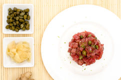 Tatar of raw tuna fish with capers Royalty Free Stock Photos