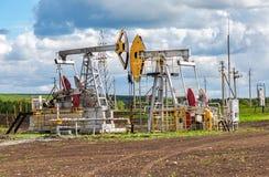 Working pump jack fracking crude extraction machine royalty free stock photos