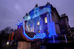 Tate Britain Art Gallery exterior. London, England - January 2019 : Tate Britain Art Gallery exterior showing giant illuminated slugs by Monster Chetwynd royalty free stock photos