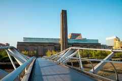 Tate Modern Exhibition centre on South Bank of Thames river, view from Millennium bridge. London Royalty Free Stock Photo