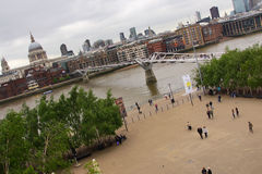 Tate Modern in London Exhibitions. Area in front of the Tate Modern Museum in London with Exhibitions announcements and river Thames on the background Royalty Free Stock Photos