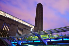 Tate Modern and the Millennium Bridge. At dusk in London Stock Images