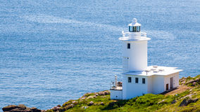 Tater Du Lighthouse Cornwall. The 1960s Tater Du Lighthouse near Lamorna Cove Cornwall England UK Royalty Free Stock Photo